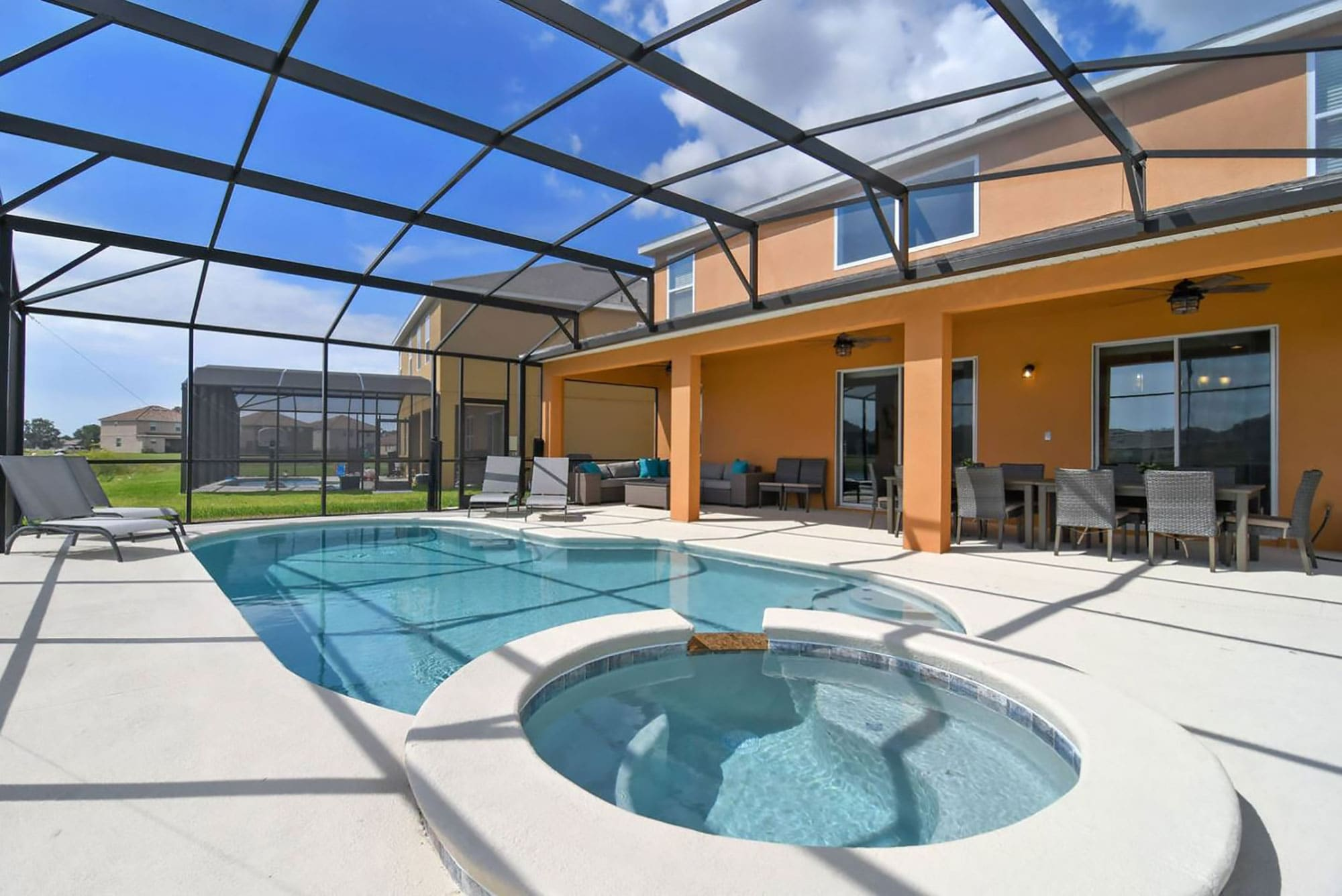Pool and hot tub area of two story vacation rental home managed by An Owners Dream Management in Davenport