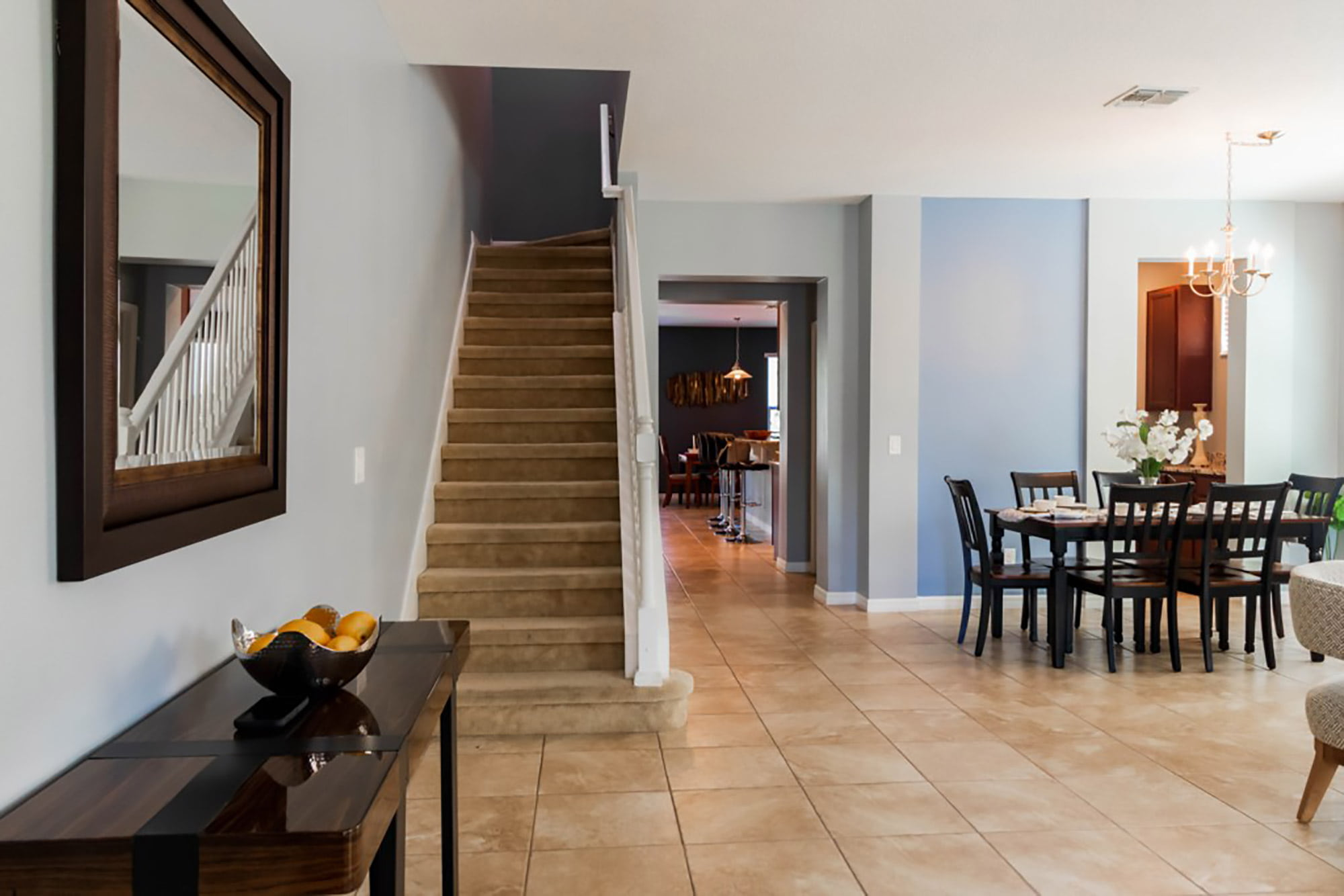 entryway stairs, and dining area of home managed by JC Vacation Homes
