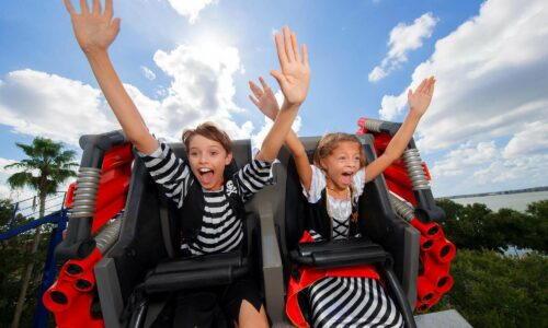 2 kids on roller coaster during LEGOLAND Florida Piratefest Weekend