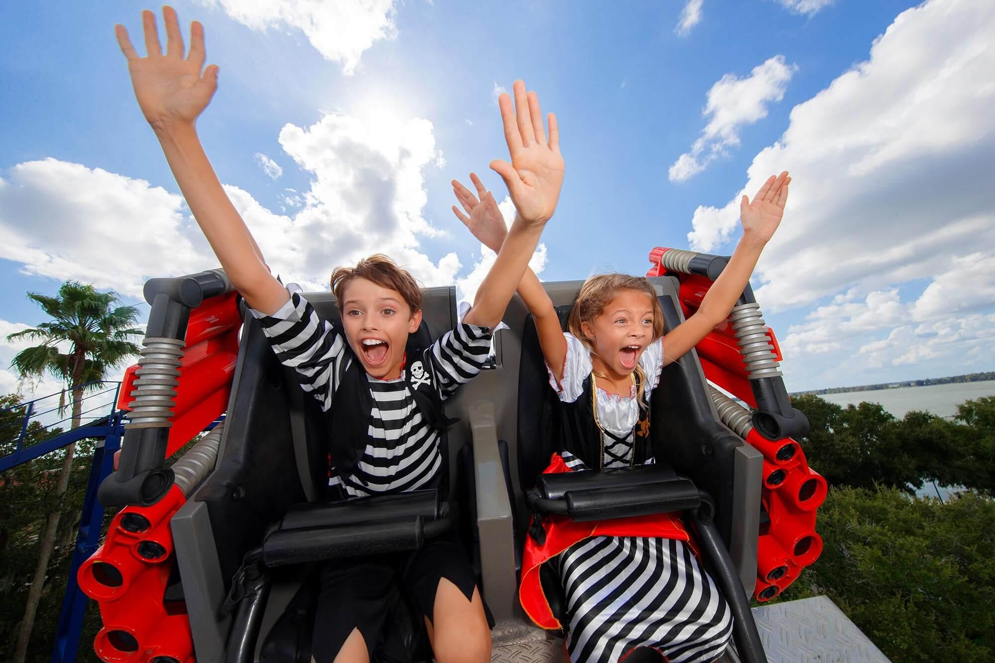 2 kids on roller coaster during LEGOLAND Florida Piratefest Weekend
