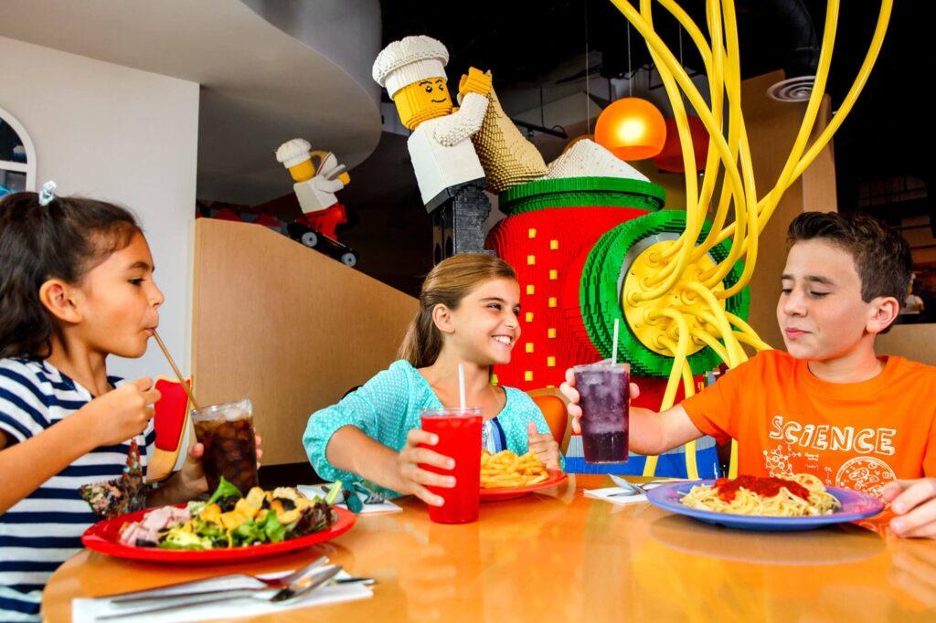 3 kids eating lunch at LEGOLAND's Bricks Family Restaurant