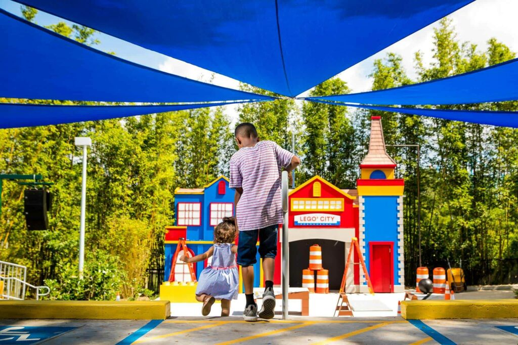 young boy and toddler entering LEGO City Stage Show at LEGOLAND Florida