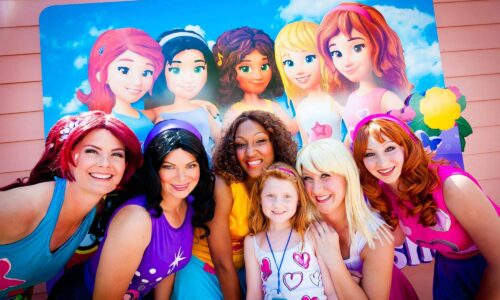 young girl with 4 LEGO Friends outside at LEGOLAND Florida