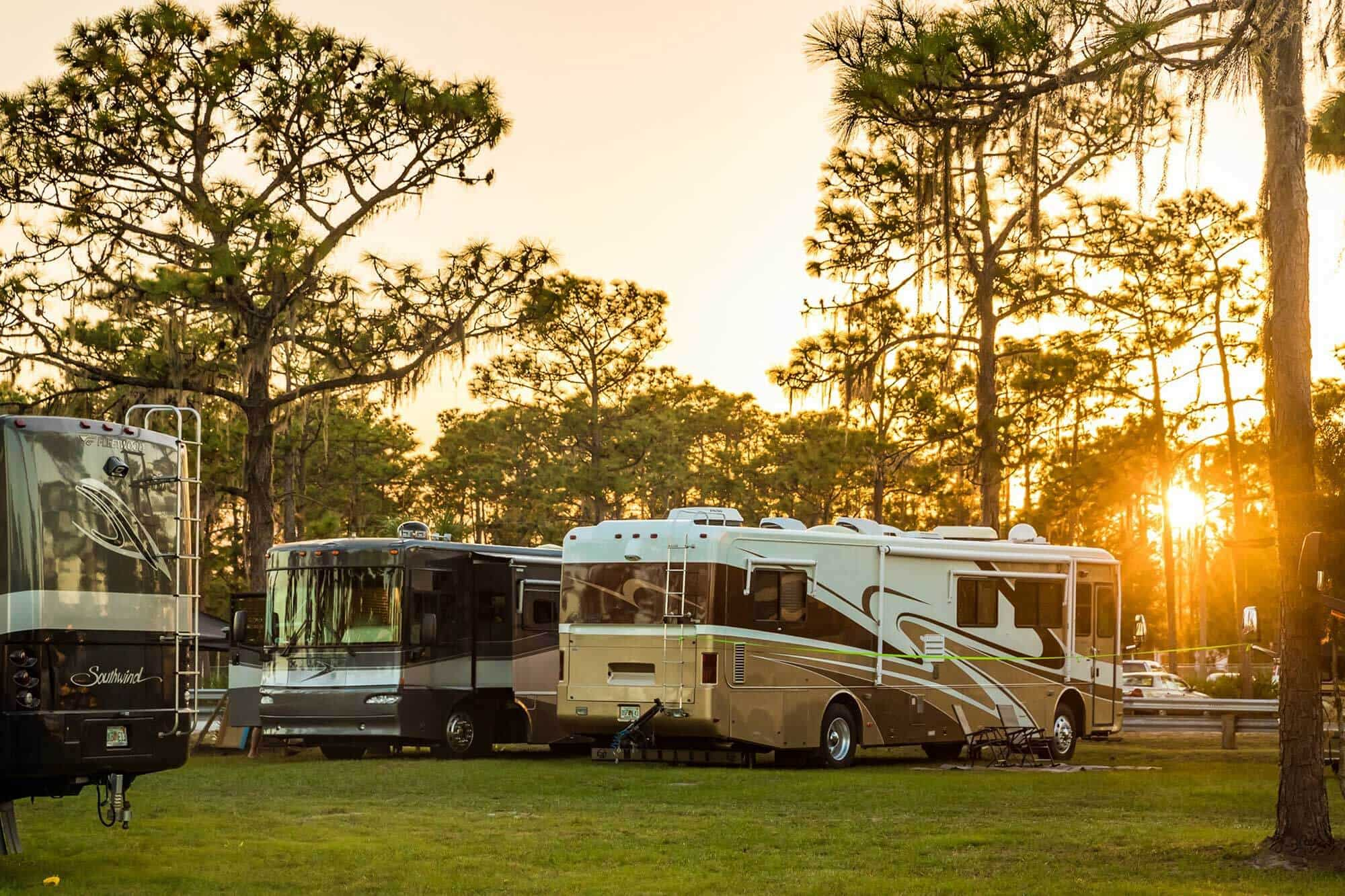 Resort at Canopy Oaks in Lake Wales, FL pre construction image showing RVs on grass under trees