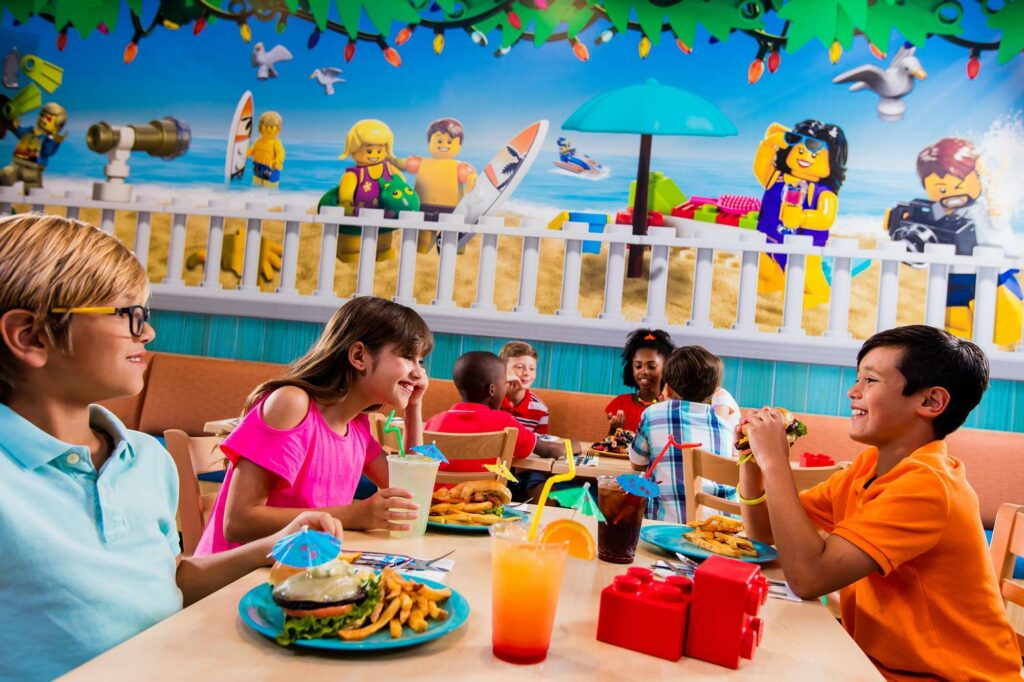 kids eating inside Sandy's Castle Restaurant at LEGOLAND Beach Retreat