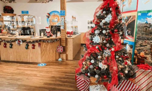 Christmas tree and presents at Central Florida's Visitor Information Center for 12 Days of Christmas Giveaways in Davenport