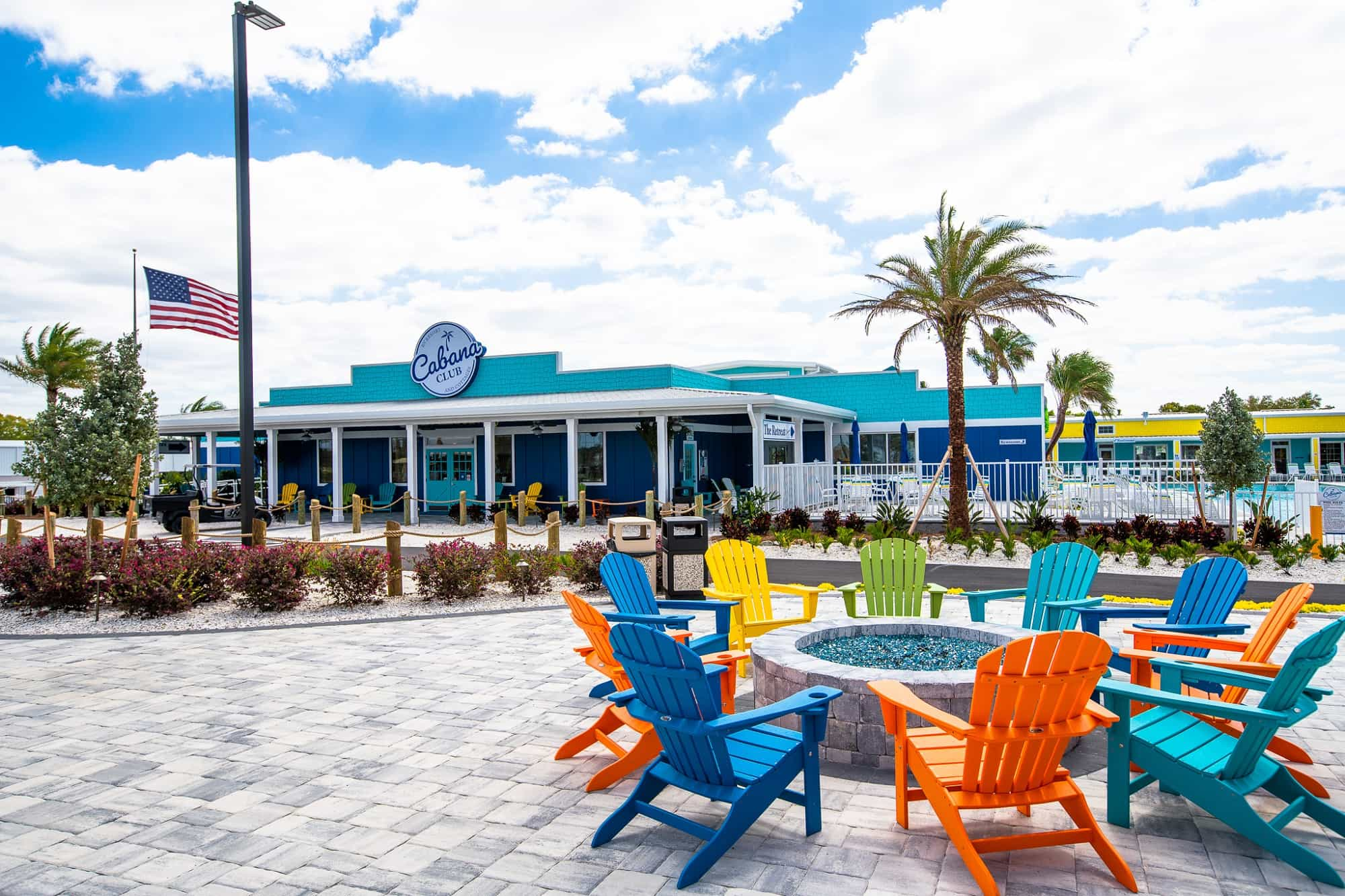 Patio and check-in building at Cabana Club Resort featuring cottages and RV slots.