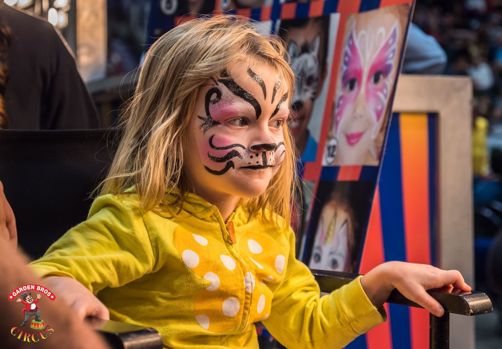 child with face paint at Garden Bros Circus event