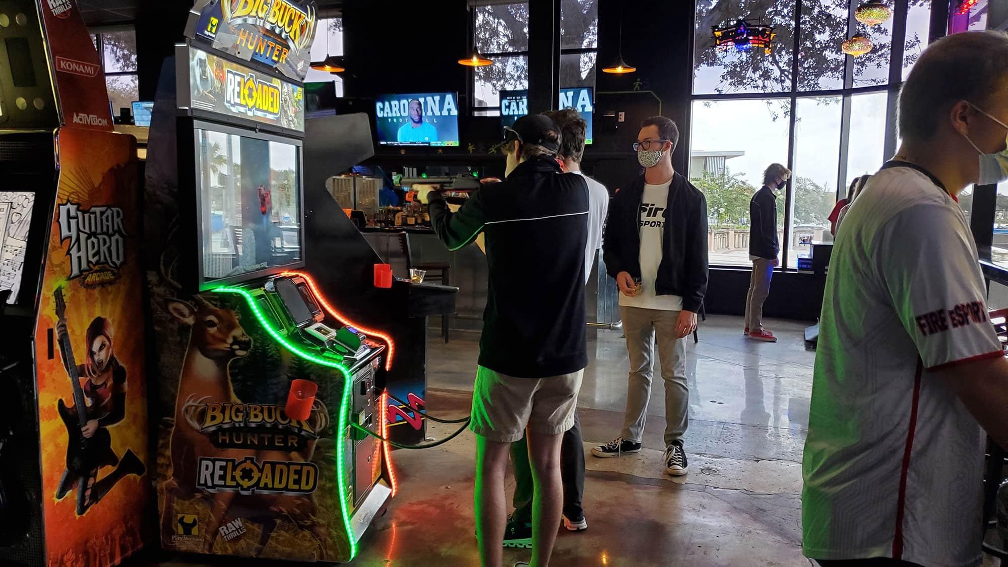 3 men playing video games at Rec Room Lakeland