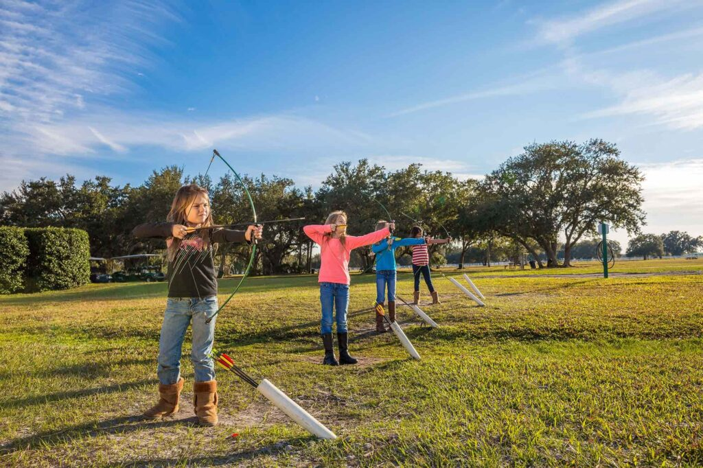 4 kids shooting arrows at Westgate River Ranch Resort near Lake Wales, FL