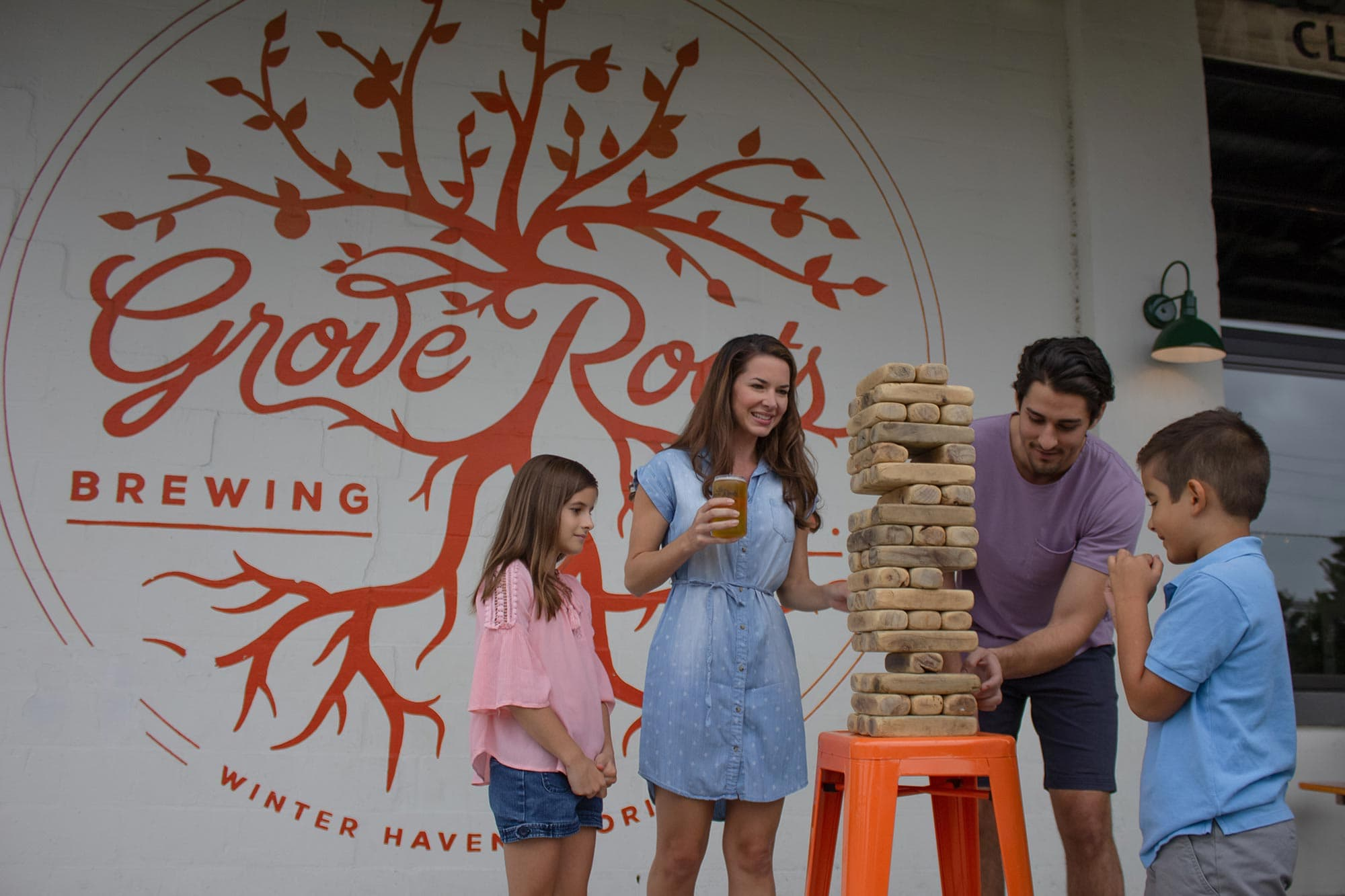 family playing Jenga at Grove Roots Brewing Co. in Winter Haven, FL