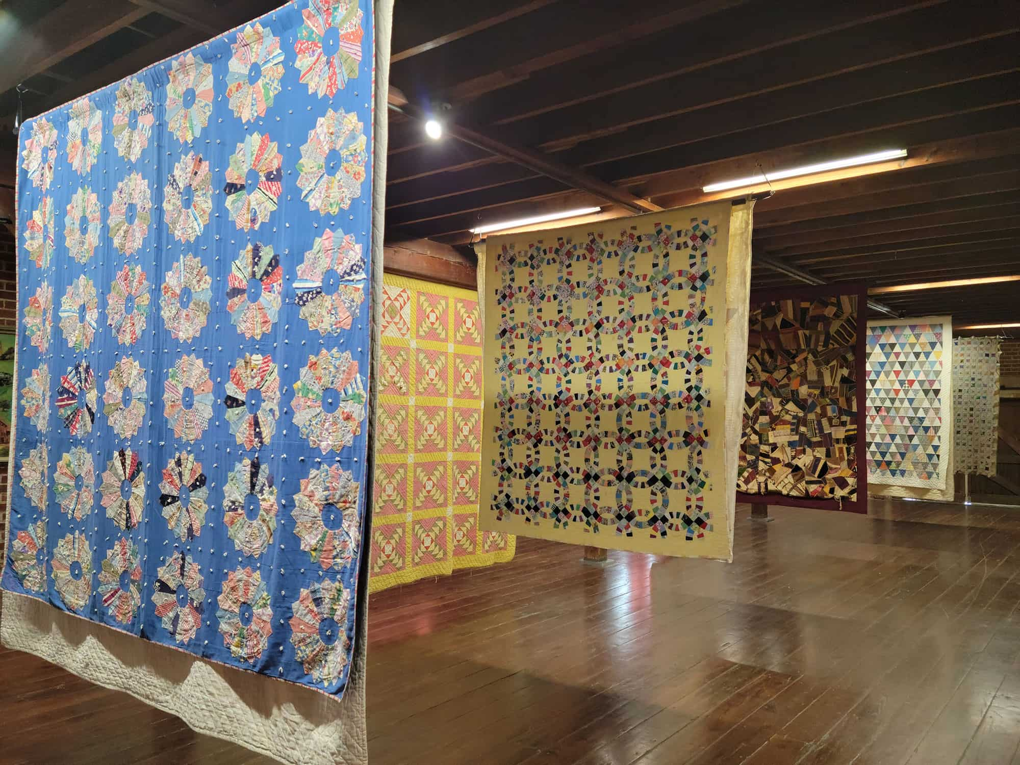 Quilts on display at Lake Wales History Museum during Creating Community through Quilts and Art exhibit Spring 2021