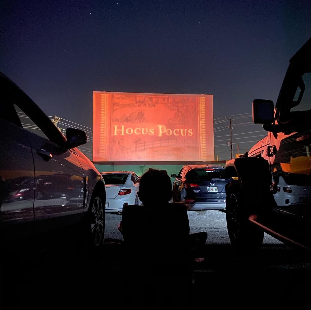 Drive-in movie theatre with hocus pocus on the screen